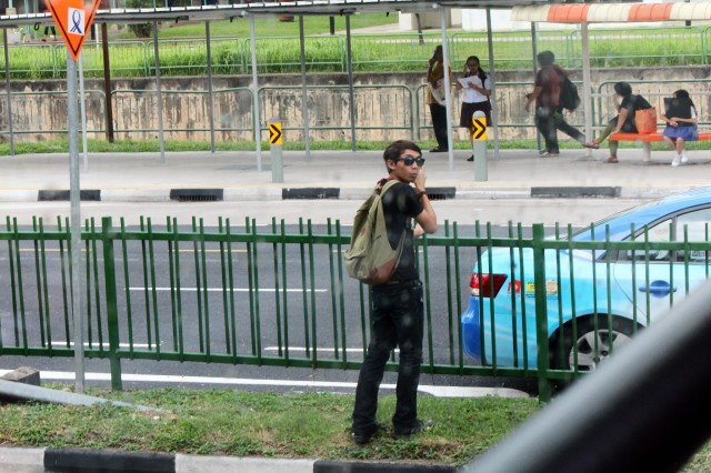 Taking photos on the centre divider of a busy road only draws attention to oneself