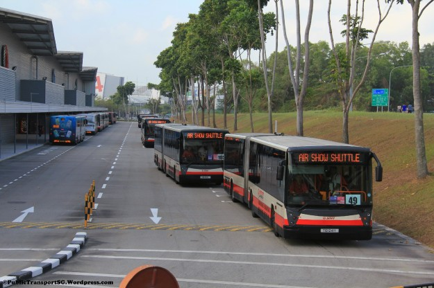 Shuttle buses leaving Singapore Expo with more buses in the background