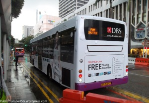 The rear of SBS8034T, one of the shuttle buses, with the DBS Bank Christmas Bus advertisement.